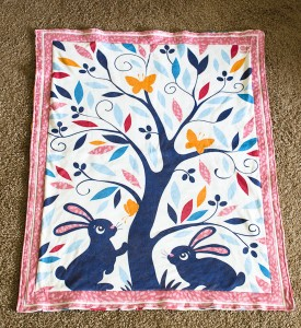 Baby blanket with bunnies under an olive tree - fabric design by Oksancia