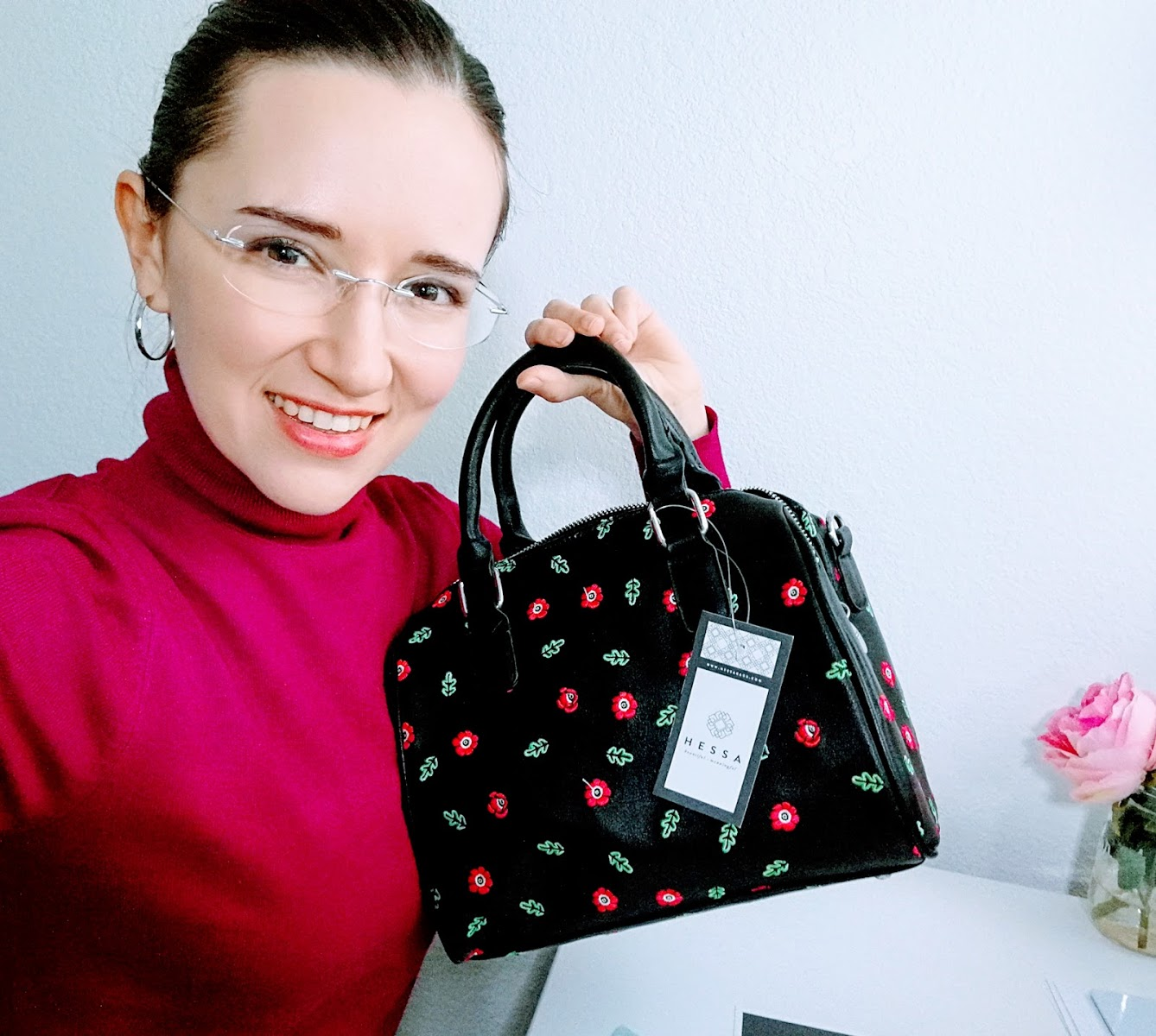 Oksancia holding Poppy pattern embroidered bag by Hessa Bags.